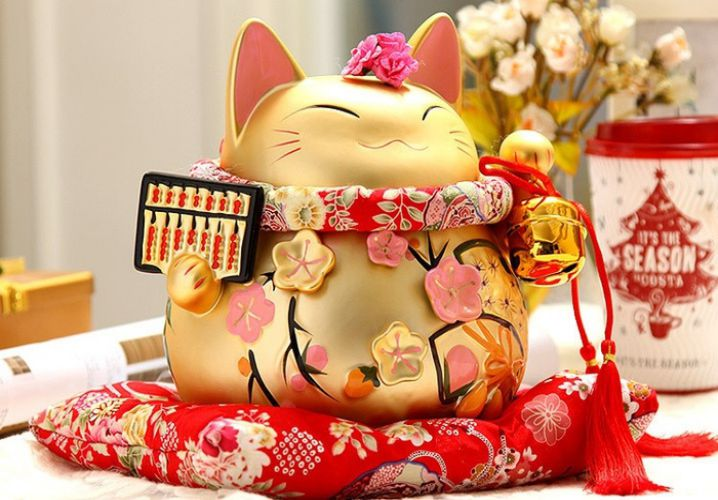 Mèo thần tài tượng trưng cho may mắn, tiền tài và sự thịnh vượng